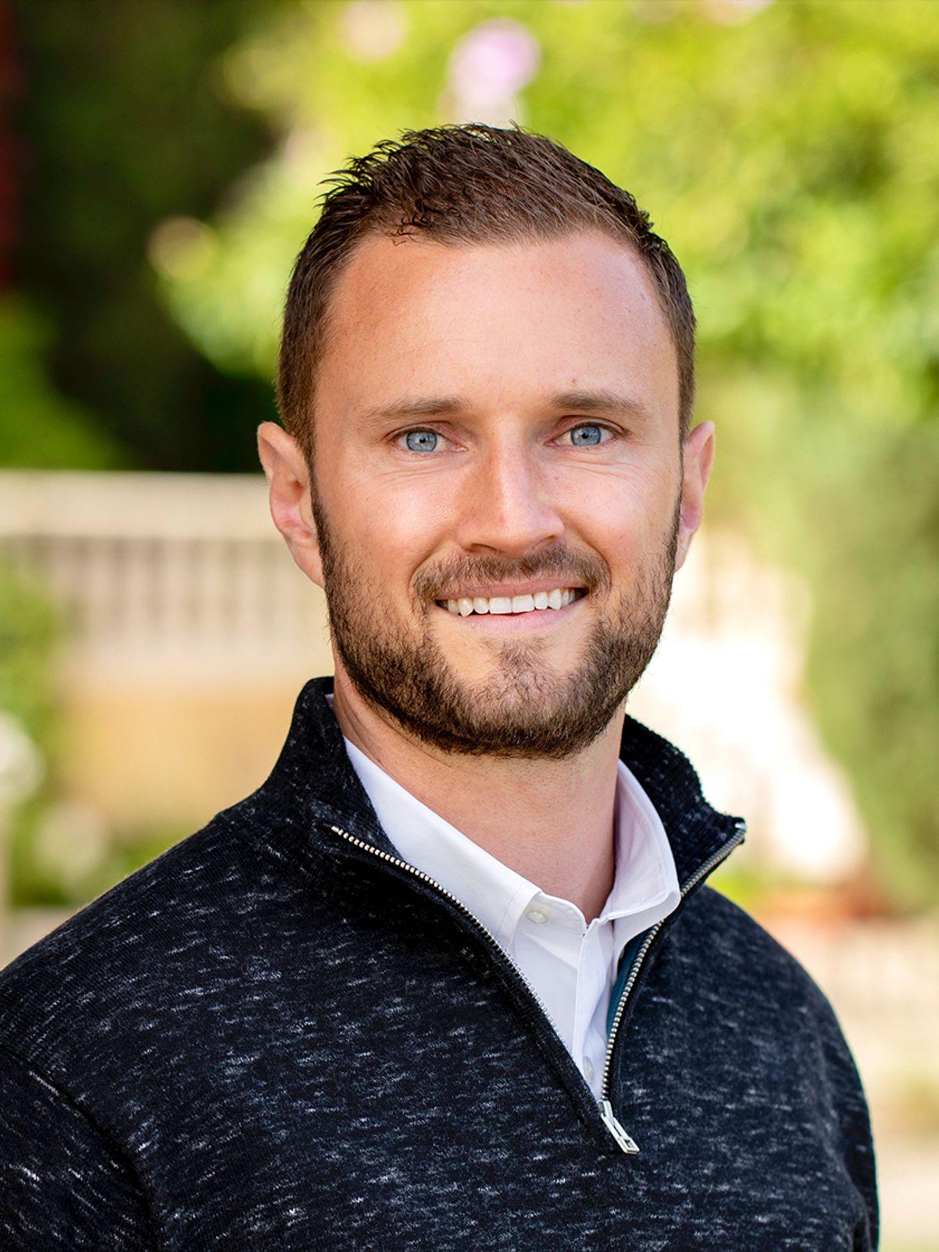 Dustin J Baker